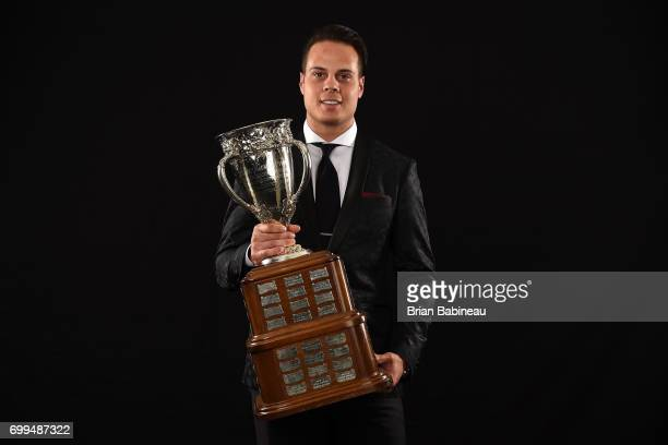 Auston Matthews of the Toronto Maple Leafs poses for a portrait with the Calder Memorial Trophy at the 2017 NHL Awards at TMobile Arena on June 21...