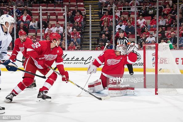 Auston Matthews of the Toronto Maple Leafs scores a first period goal past goaltender Petr Mrazek and defenseman Jonathan Ericsson of the Detroit Red...