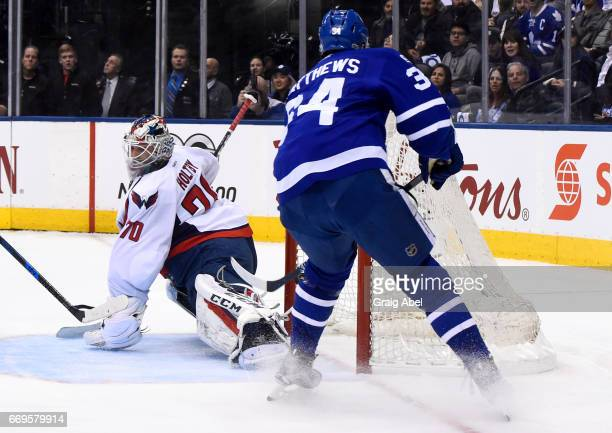 Auston Matthews of the Toronto Maple Leafs scores on Braden Holtby of the Washington Capitals during the first period in Game Three of the Eastern...