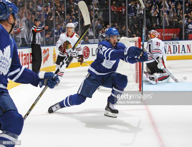 Auston Matthews of the Toronto Maple Leafs scores the overtime winning goal against the Chicago Blackhawks in an NHL game at the Air Canada Centre on...