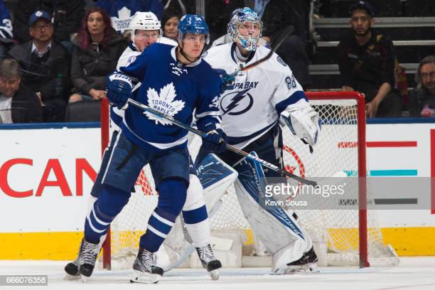 Auston Matthews of the Toronto Maple Leafs screens Andrei Vasilevskiy of the Tampa Bay Lightning as Andrej Sustr of the Tampa Bay Lightning attempts...