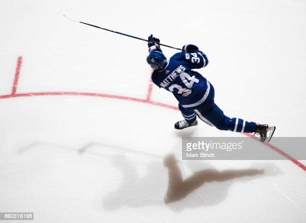 Auston Matthews of the Toronto Maple Leafs shoots during warm up before facing the New Jersey Devils at the Air Canada Centre on October 11 2017 in...