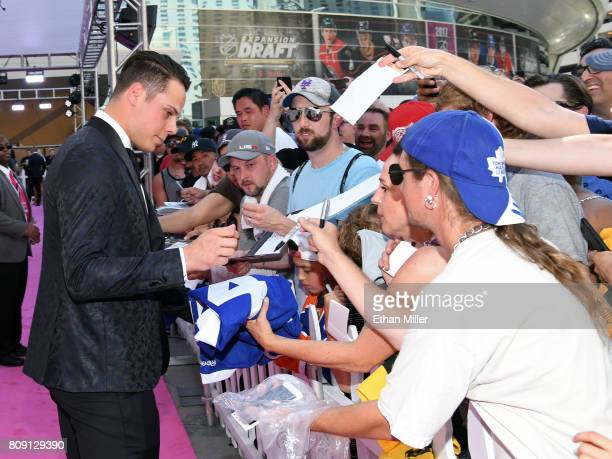 Auston Matthews of the Toronto Maple Leafs signs autographs for fans as he attends the 2017 NHL Awards at TMobile Arena on June 21 2017 in Las Vegas...