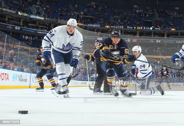 Auston Matthews of the Toronto Maple Leafs skates against Tyler Ennis of the Buffalo Sabres during an NHL game at the KeyBank Center on April 3 2017...