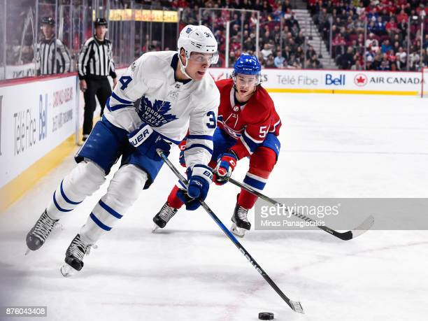 Auston Matthews of the Toronto Maple Leafs skates the puck against Charles Hudon of the Montreal Canadiens during the NHL game at the Bell Centre on...