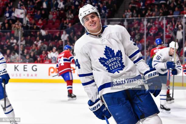 Auston Matthews of the Toronto Maple Leafs smiles after scoring a goal in the third period against the Montreal Canadiens during the NHL game at the...