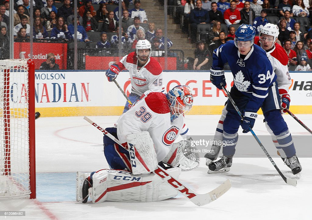 Auston Matthews # 34 of theToronto Maple Leafs watches a goal on Mike Condon #39 of the Montreal Canadiens scored by Morgan Rielly #44 of the Toronto Maple Leafs, not seen, during the third period of their NHL preseason game at the Air Canada Centre on October 2, 2016 in Toronto, ON, Canada.
