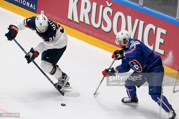 Auston Matthews of USA in acion with Damien Fleury of France during the 2016 IIHF World Championship between France and USA at Yubileyny Sports...