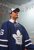 Auston Matthews stands on the draft floor after being selected first overall by the Toronto Maple Leafs in the 2016 NHL Draft at First Niagara Center...