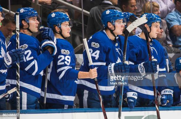 Auston Matthews William Nylander and Patrick Marleau of the Toronto Maple Leafs cheer from the bench while playing the New Jersey Devils during the...