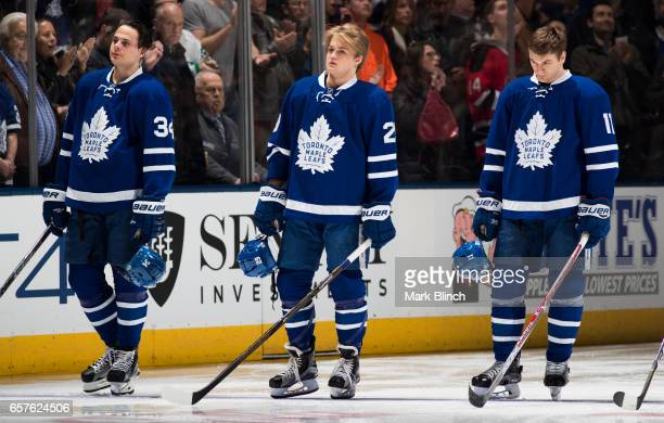 Auston Matthews William Nylander and Zach Hyman of the Toronto Maple Leafs stand in the ice during the anthems prior to the game against the New...
