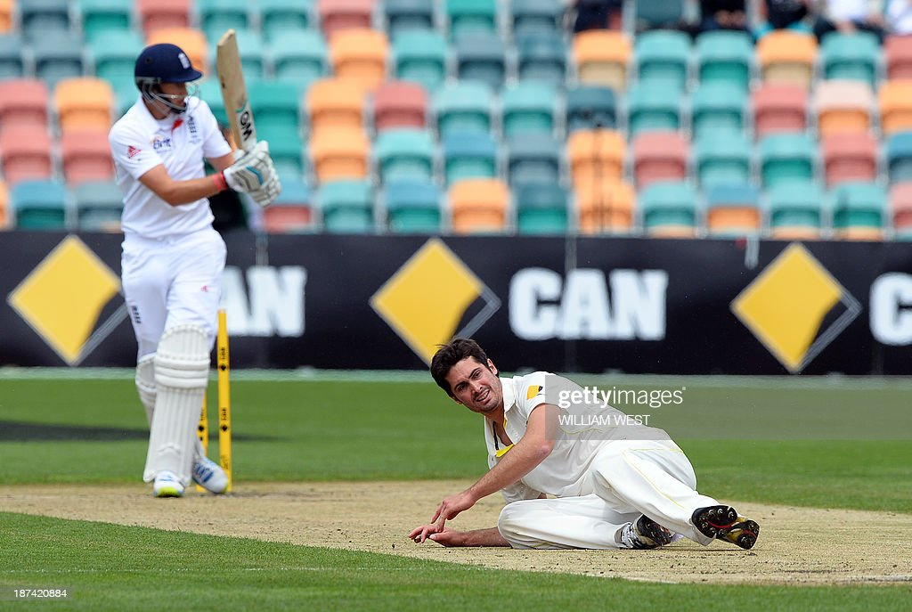 Australia A paceman Ben Cutting (R) falls after England batsman Joe Root (L) pulled the ball to the boundary on the final day of their cricket match played at the Bellerive Oval in Hobart on November 9, 2013. AFP PHOTO/William WEST IMAGE RESTRICTED TO EDITORIAL USE - STRICTLY NO COMMERCIAL USE