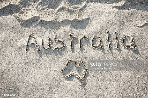 Australia and map of Australia written in sand