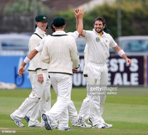 Australia A's Chadd Sayers celebrates with team mates after taking his fifth wicket of the first innings Gloucestershire's James Fuller for 0
