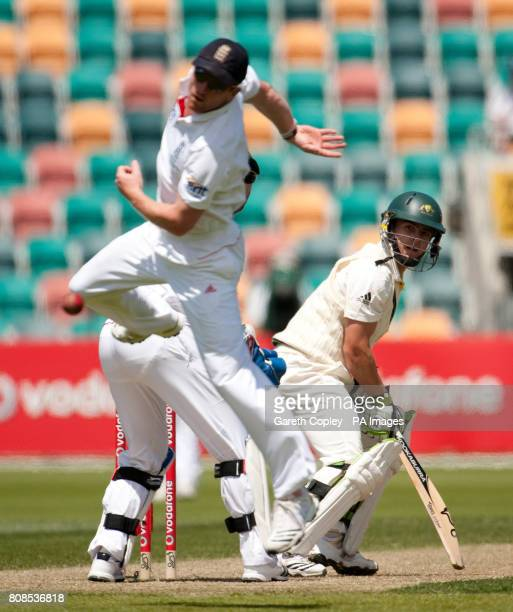 Australia A's Steve O'Keefe looks back as England's Paul Collingwood stops the ball during the tour match at the Bellerive Oval Hobart Australia