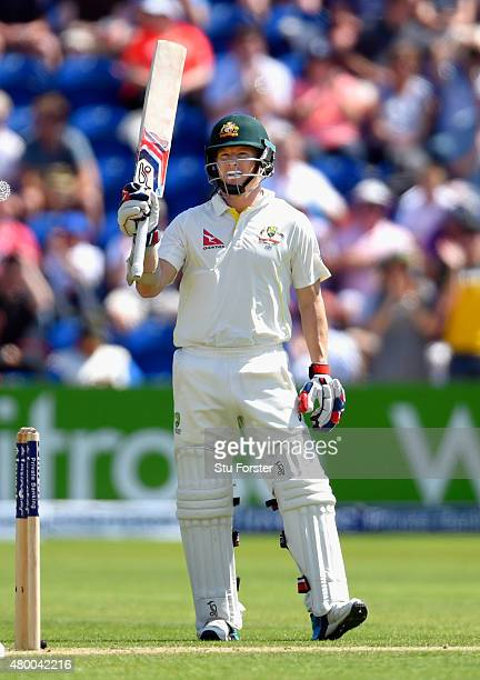Australia batsman Chris Rogers raises his bat after reaching his half century during day two of the 1st Investec Ashes Test match between England and...