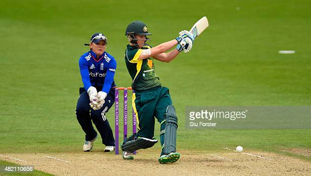 Australia batsman Elyse Villani hits out watched by wicketkeeper Sarah Taylor during the 3rd Royal London ODI of the Women's Ashes Series between...