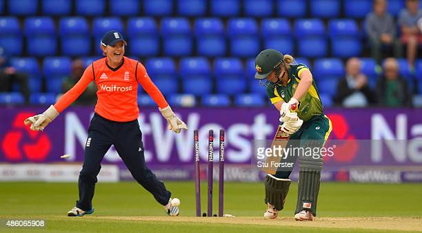 Australia batsman Meg Lanning is bowled as wicketkeeper Sarah Taylor celebrates during the 3rd NatWest T20 of the Women's Ashes Series between...