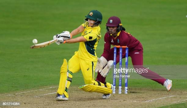 Australia batsman Nicole Bolton pulls a ball to the boundary watched by wicketkeeper Merissa Aguilleira during the ICC Women's World Cup 2017 match...