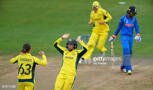 Australia bowler Ashleigh Gardner is congratulated by Alex Blackwell after dismissing India batsman Smrti Mandhana during the ICC Women's World Cup...