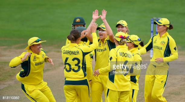 Australia bowler Ashleigh Gardner is congratulated by team mates after dismissing India batsman Smrti Mandhana during the ICC Women's World Cup 2017...