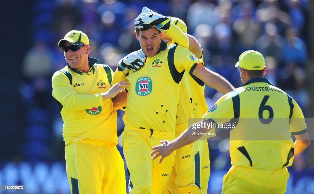 Australia bowler Clint Mckay (c) celebrates after completing his hatrick by dismissing England batsman Joe Root during the 4th NatWest Series ODI between England and Australia at SWALEC Stadium on September 14, 2013 in Cardiff, Wales.