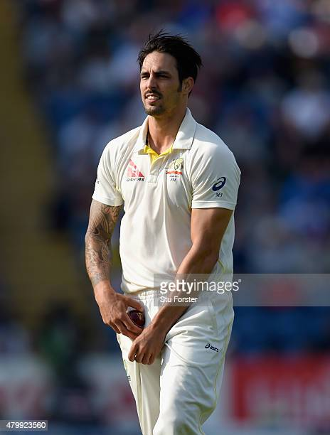 Australia bowler Mitchell Johnson shines the new ball during day one of the 1st Investec Ashes Test match between England and Australia at SWALEC...