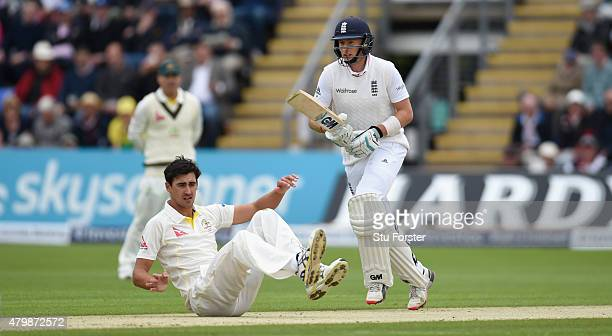 Australia bowler Mitchell Starc looks on as England batsman Joe Root picks up some runs during day one of the 1st Investec Ashes Test match between...