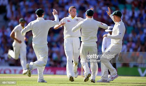 Australia bowler Peter Siddle and team mates celebrates after bowling England batsman Ian Bell during day two of the 5th Investec Ashes Test match...