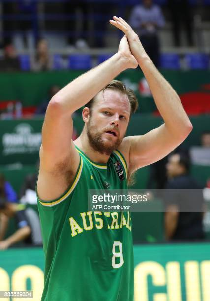Australia' Brad Newley celebrates scoring against New Zealand's team during their 2017 FIBA Asia Cup semifinal basketball match in the Lebanese town...