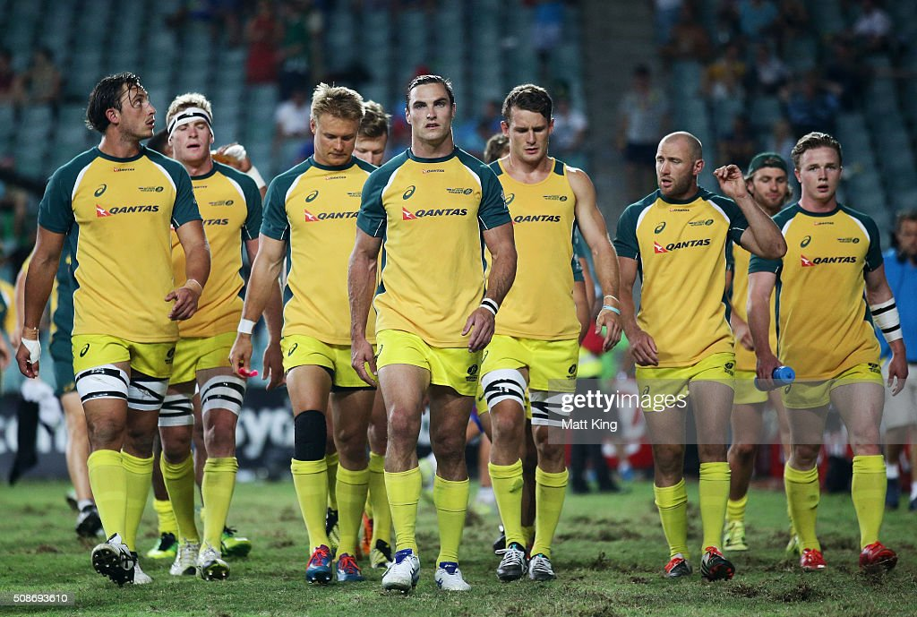 Australia captain <a gi-track='captionPersonalityLinkClicked' href=/galleries/search?phrase=Ed+Jenkins+-+Rugby+Player&family=editorial&specificpeople=14322294 ng-click='$event.stopPropagation()'>Ed Jenkins</a> (C) leads his team away after their warm up prior to their match against New Zealand during the 2016 Sydney Sevens at Allianz Stadium on February 6, 2016 in Sydney, Australia.