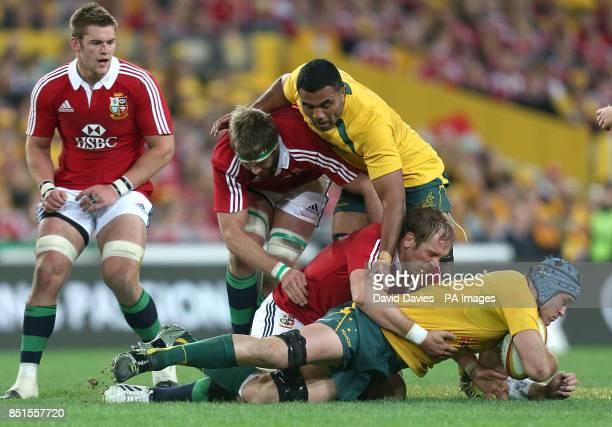 Australia captain James Horwill is tacked by British and Irish Lions captain AlunWyn Jones