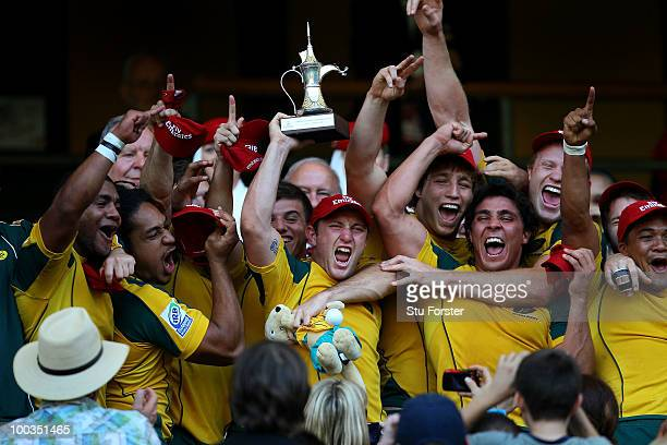 Australia captain James Stannard lifts the Cup Final Trophy after beating Australia beat South Africa during day two of the IRB London Sevens at...