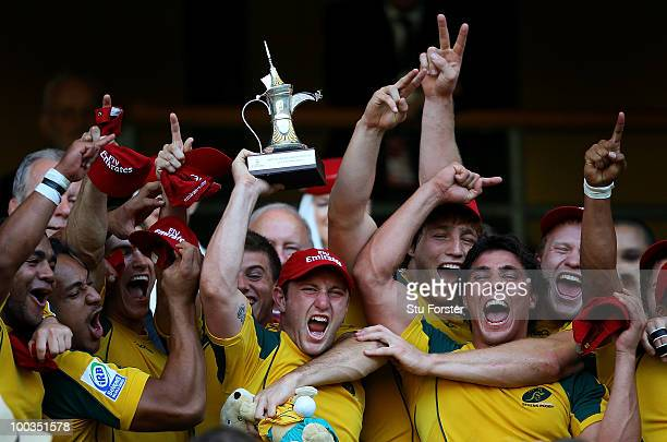 Australia captain James Stannard lifts the Cup Final Trophy with team mates after Australia beat South Africa during day two of the IRB London Sevens...