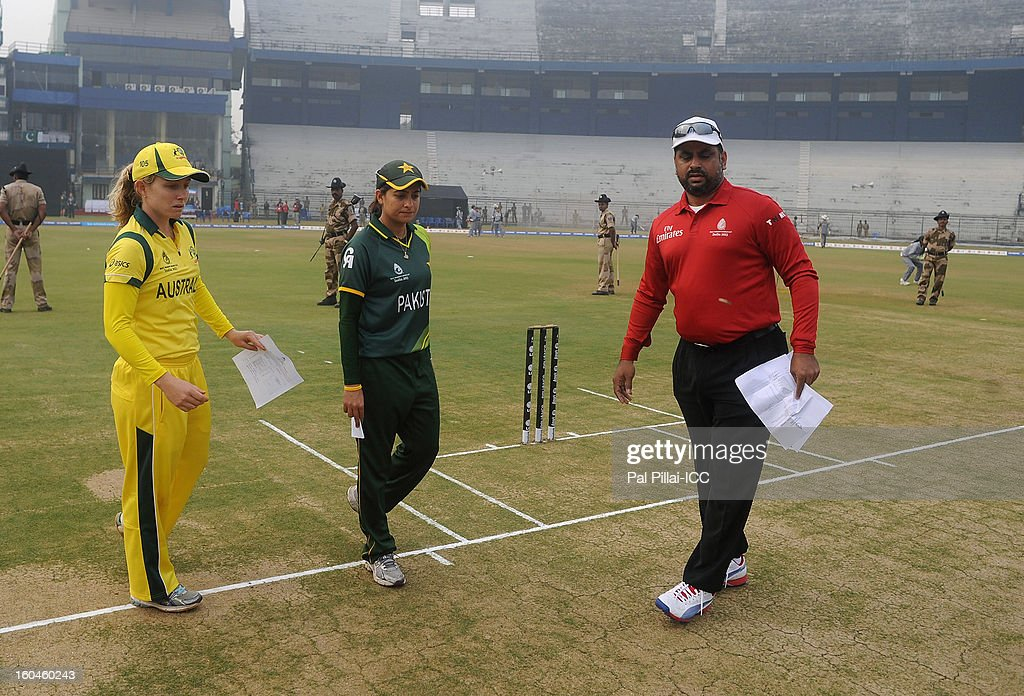 Australia captain Jodie Fields (L) and Pakistan captain Sana Mir during the toss before the start of the second match of ICC Womens World Cup between Australia and Pakistan, played at the Barabati stadium on February 1, 2013 in Cuttack, India.