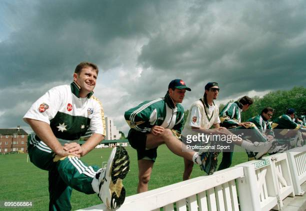 Australia captain Mark Taylor and members of the Australia Cricket Team stretching during a practice session on the Nursery Ground of Lord's Cricket...