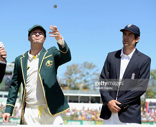 Australia captain Michael Clarke tosses the coin alongside England captain Alastair Cook ahead of day one of the Third Ashes Test Match between...