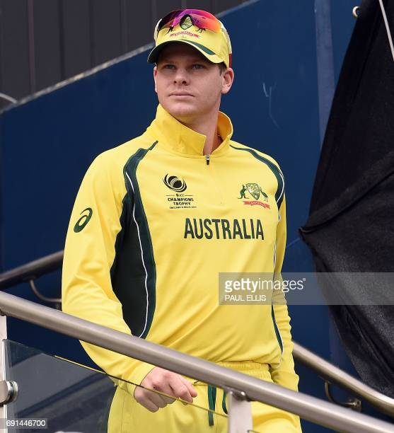 Australia captain Steve Smith prepares to lead his team out for the ICC Champions trophy cricket match between Australia and New Zealand at Edgbaston...