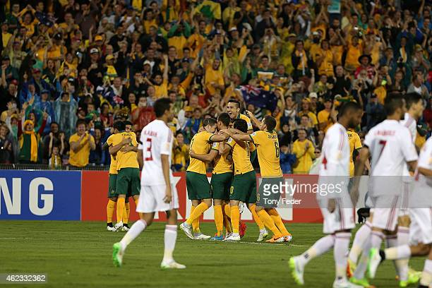 Australia celebrate a goal during the Asian Cup Semi Final match between the Australian Socceroos and the United Arab Emirates at Hunter Stadium on...