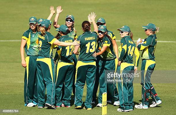 Australia celebrate a wicket by Rene Farrell during game two of the women's international one day series between Australia and the West Indies at...