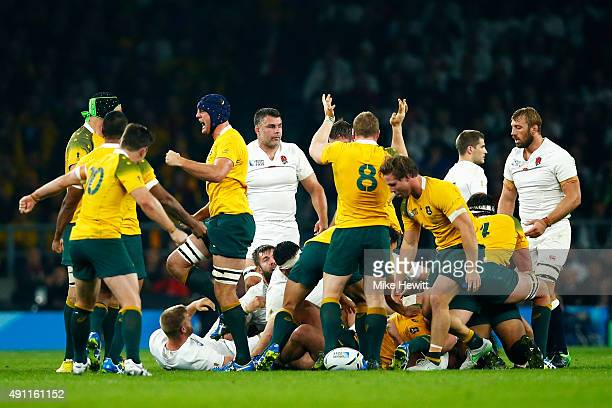 Australia celebrate after getting a penalty from a scrum during the 2015 Rugby World Cup Pool A match between England and Australia at Twickenham...