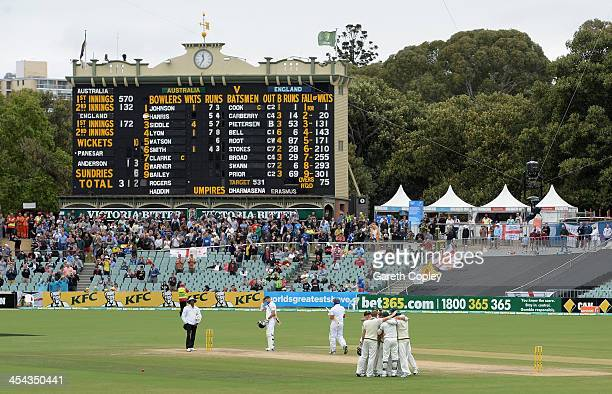 Australia celebrate after Ryan Harris of Australia dismisses Monty Panesar of England to win the Second Ashes Test Match between Australia and...