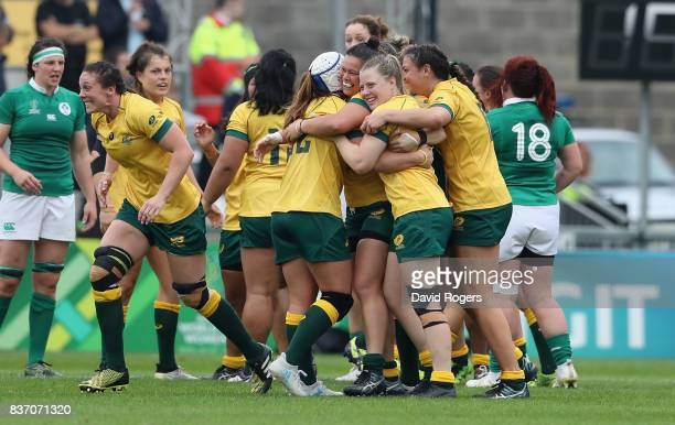 Australia celebrate after their victory during the Women's Rugby World Cup 2017 match between Ireland and Australia at the Kingspan Stadium on August...