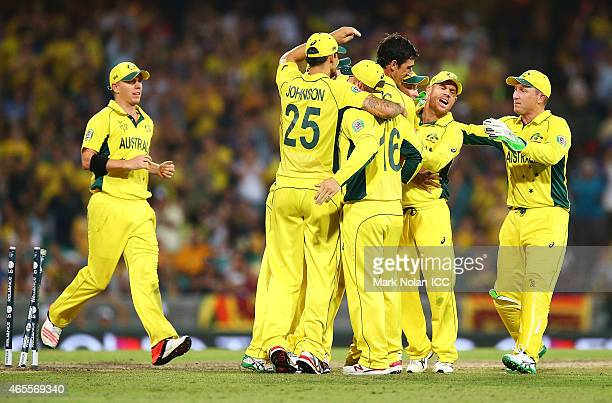 Australia celebrate as Mahela Jayawardene of Sri Lanka is run out by Michael Clarke of Australia during the 2015 ICC Cricket World Cup match between...