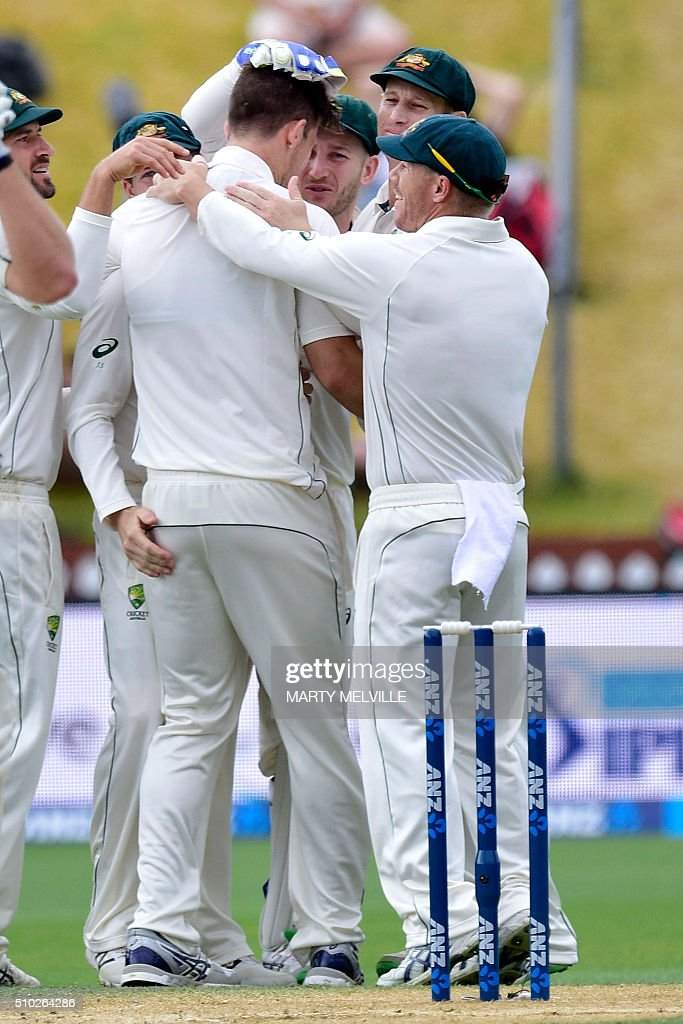 Australia celebrate New Zealand's Corey Anderson being caught with LBW during day four of the first cricket Test match between New Zealand and Australia at the Basin Reserve in Wellington on February 15, 2016. / AFP / Marty Melville
