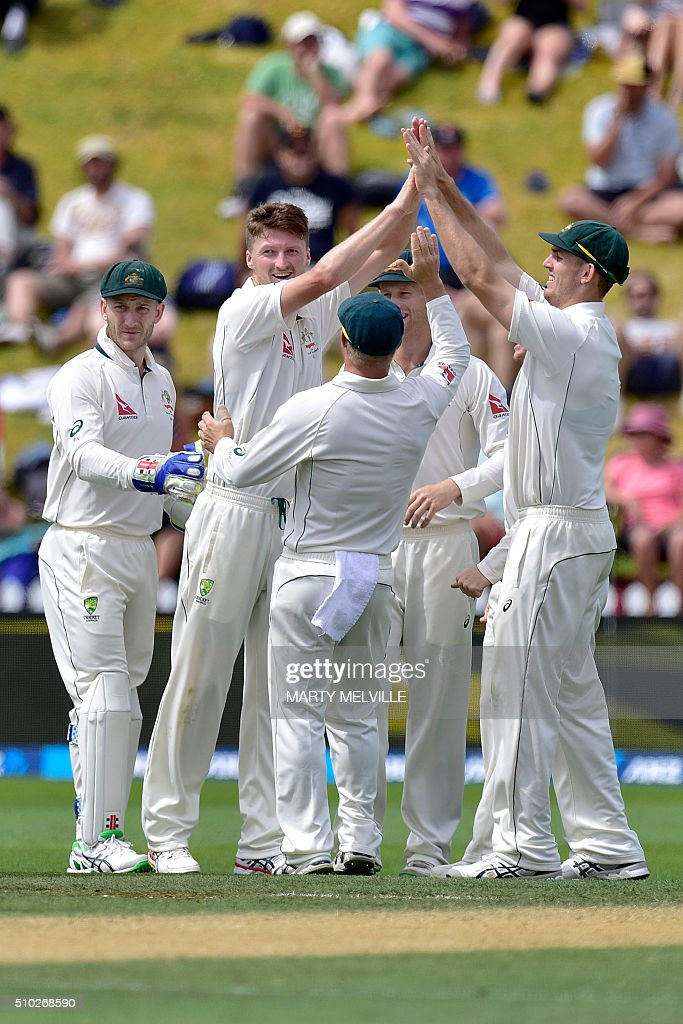 Australia celebrate New Zealand's Henry Nicholls being bowled during day four of the first cricket Test match between New Zealand and Australia at the Basin Reserve in Wellington on February 15, 2016. / AFP / Marty Melville