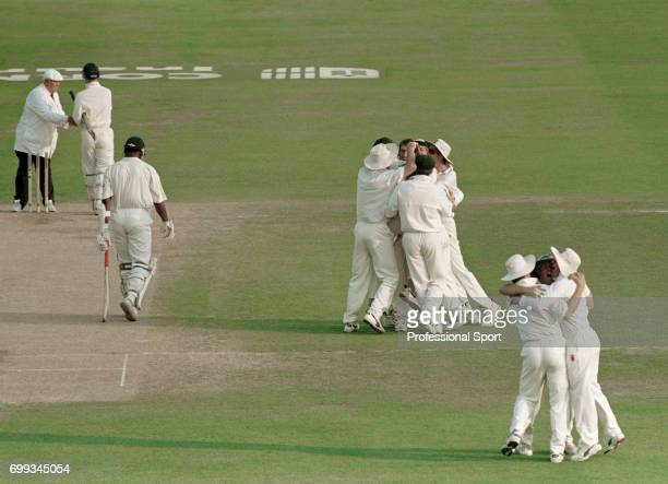 Australia celebrate taking the last England wicket of Devon Malcolm to win the 5th Test match between England and Australia at Trent Bridge...