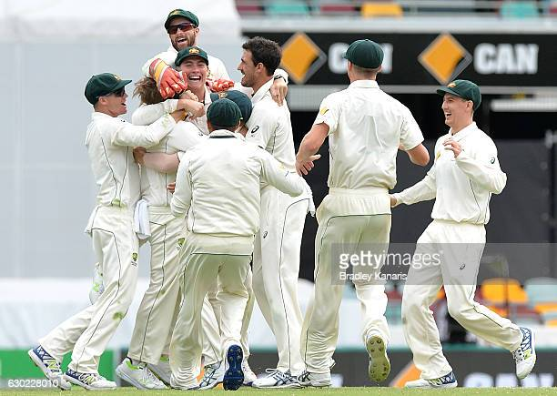 Australia celebrate victory during day five of the First Test match between Australia and Pakistan at The Gabba on December 19 2016 in Brisbane...