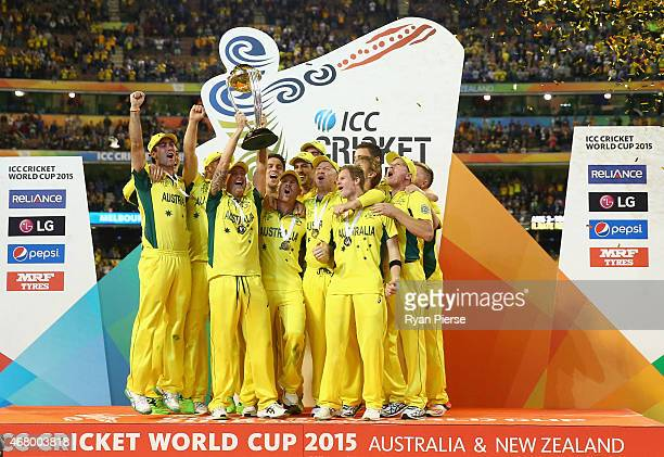 Australia celebrate victory with the world cup trophy during the 2015 ICC Cricket World Cup final match between Australia and New Zealand at...