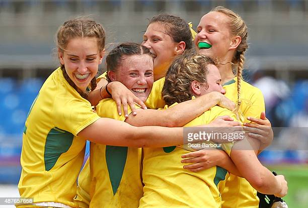 Australia celebrate winning the gold medal at full time during the Rugby Sevens Women's Final match between Australia and Canada at the Apia Park...
